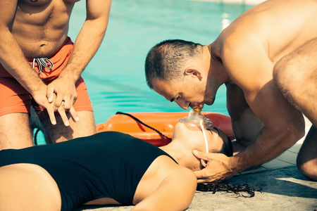 lifeguard performing CPR