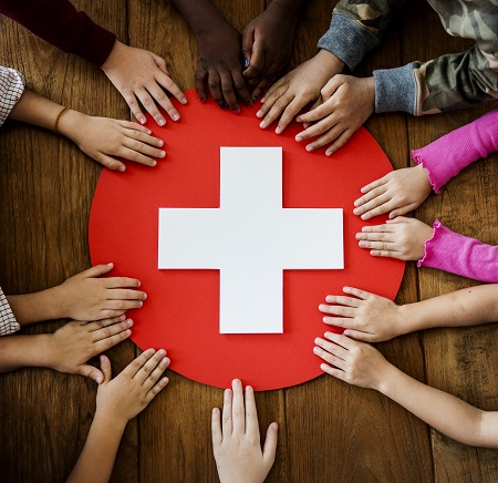 Children Holding a Red Cross